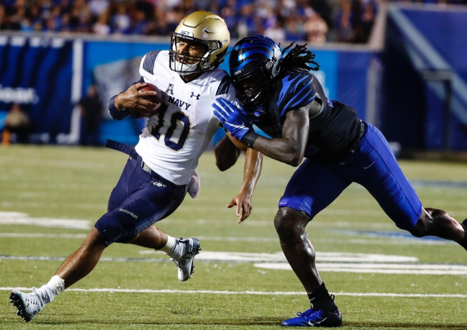 <strong>Navy quarterback Malcolm Perry (left, with ball, playing Memphis Sept. 26) will be the focus of both teams during the Liberty Bowl. Perry needs only 177 yards rushing to set the NCAA's all-time single-season record for a quarterback.</strong> (Mark Weber/Daily Memphian)