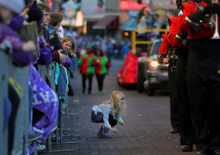 <strong>A young Kansas State fan cautiously eyes one of the marching bands while trying to snag a few extra pieces of candy during the AutoZone Liberty Bowl Parade Dec. 30, 2019.</strong> (Patrick Lantrip/Daily Memphian)