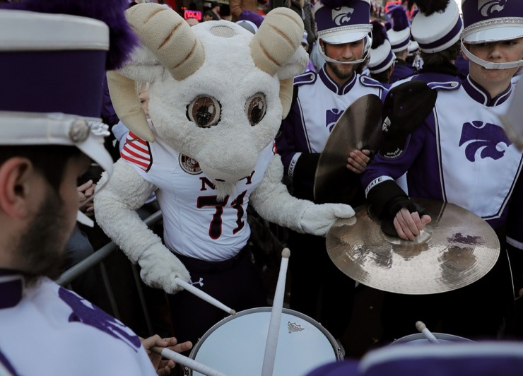 <strong>Bill the Goat, the Naval Academy's mascot, jumps in for an impromptu set with the Kansas State Band during the AutoZone Liberty Bowl Parade Dec. 30, 2019.</strong> (Patrick Lantrip/Daily Memphian)