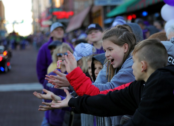 <strong>A young Kansas State fan keeps her eye on the prize, which happens to be a piece of candy thrown from a float during the AutoZone Liberty Bowl Parade Dec. 30, 2019.</strong> (Patrick Lantrip/Daily Memphian)