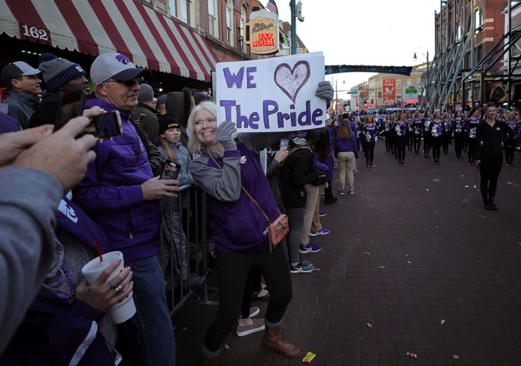 <strong>A Kansas State fan shows off her sign to her fellow Wildcat fans during the AutoZone Liberty Bowl Parade Dec. 30, 2019.</strong> (Patrick Lantrip/Daily Memphian)