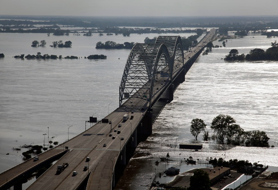 <strong>Suspects fled from Midtown across the Hernando de Soto Bridge to Arkansas, above, where the chase ended in a shootout.</strong> (Lance Murphey/Daily Memphian)