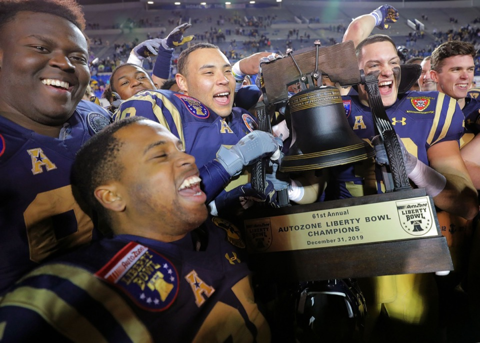 <strong>Navy players celebrate by hoisting the trophy after winning the 61st AutoZone Liberty Bowl Dec. 31, 2019.</strong> (Patrick Lantrip/Daily Memphian)