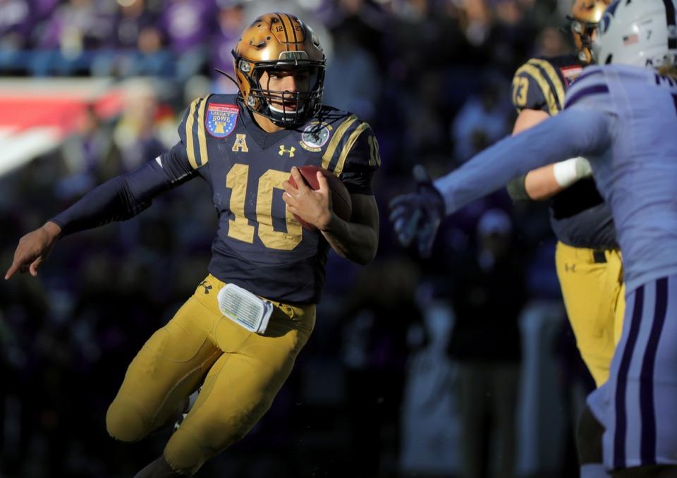 <strong>Navy quarterback Malcom Perry (10) scrambles past a Kansas State University defender at the AutoZone Liberty Bowl Dec. 31, 2019. Perry had a big day.</strong> (Patrick Lantrip/Daily Memphian)