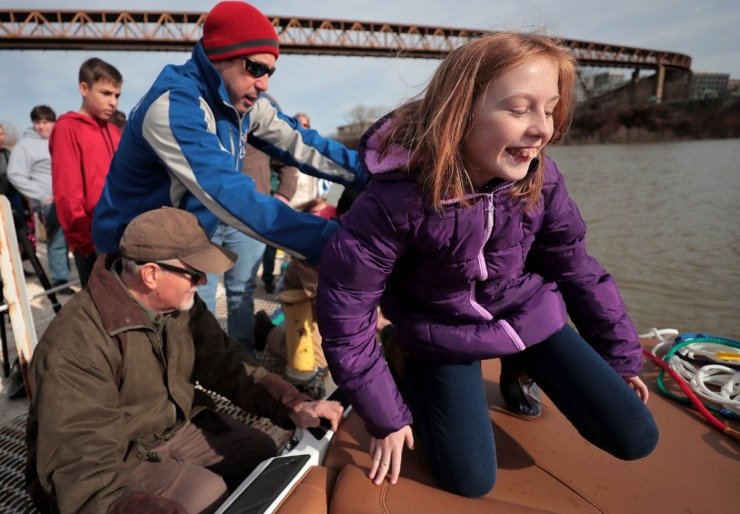 <strong>This year's beneficiary, 11-year-old Allie Gibson boards the ski boat for a close-up view of the skiiers during the 43rd annual Ski Freeze at the Mud Island River Park on Jan. 1, 2020. Hosted by the Collierville Ski Club, water skiers, barefooters and wakeboarders braved the frigid water of the Wolf River to raise money for The Dream Factory of Memphis which grants wishes for critically and chronically ill children ages 3 through 18.</strong> (Jim Weber/Daily Memphian)