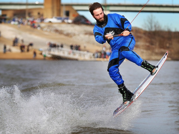 <strong>Drew Williams catches some air while wakeboarding during the 43rd annual Ski Freeze at the Mud Island River Park on Jan. 1, 2020. Hosted by the Collierville Ski Club, water skiers, barefooters and wakeboarders braved the frigid water of the Wolf River to raise money for The Dream Factory of Memphis which grants wishes for critically and chronically ill children ages 3 through 18.</strong> (Jim Weber/Daily Memphian)