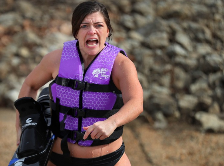 <strong>Kelsey Lawrence reacts to the cold after emerging from her dip in the Wolf River during the 43rd annual Ski Freeze at the Mud Island River Park on Jan. 1, 2020. Hosted by the Collierville Ski Club, water skiers, barefooters and wakeboarders braved the frigid water of the Wolf River to raise money for The Dream Factory of Memphis which grants wishes for critically and chronically ill children ages 3 through 18.</strong> (Jim Weber/Daily Memphian)