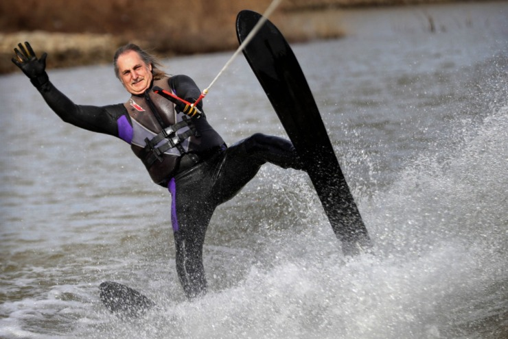 <strong>Denis Lackey tips a wave to the docks during the 43rd annual Ski Freeze at the Mud Island River Park on Jan. 1, 2020. Hosted by the Collierville Ski Club, water skiers, barefooters and wakeboarders braved the frigid water of the Wolf River to raise money for The Dream Factory of Memphis which grants wishes for critically and chronically ill children ages 3 through 18.</strong> (Jim Weber/Daily Memphian)
