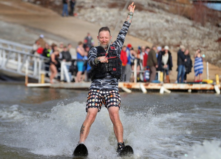 <strong>David Yancey celebrates after successfully launching from the dock during the 43rd annual Ski Freeze at the Mud Island River Park on Jan. 1, 2020. Hosted by the Collierville Ski Club, water skiers, barefooters and wakeboarders braved the frigid water of the Wolf River to raise money for The Dream Factory of Memphis which grants wishes for critically and chronically ill children ages 3 through 18.</strong> (Jim Weber/Daily Memphian)