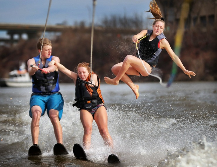 <strong>After succesfully water skiing in a pyramid formation, Ashley Piskorski (right) tumbles from the shoulders of siblings Cole (left) and Kayla Piskorski during the 43rd annual Ski Freeze at the Mud Island River Park on Jan. 1, 2020. Hosted by the Collierville Ski Club, water skiers, barefooters and wakeboarders braved the frigid water of the Wolf River to raise money for The Dream Factory of Memphis which grants wishes for critically and chronically ill children ages 3 through 18.</strong> (Jim Weber/Daily Memphian)