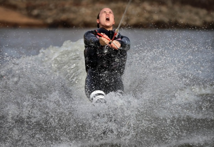 <strong>Stephanie Stooks braces against the cold as she slalom skis during the 43rd annual Ski Freeze at the Mud Island River Park on Jan. 1, 2020. Hosted by the Collierville Ski Club, water skiers, barefooters and wakeboarders braved the frigid water of the Wolf River to raise money for The Dream Factory of Memphis which grants wishes for critically and chronically ill children ages 3 through 18.</strong> (Jim Weber/Daily Memphian)