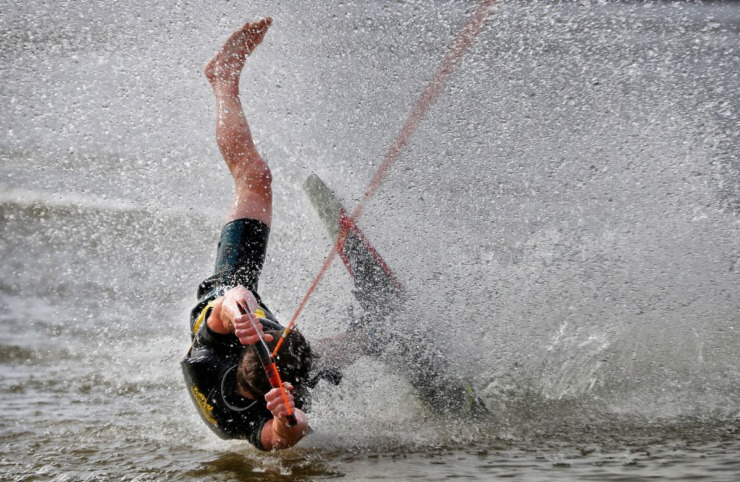 <strong>Blake Maynard takes a tumble during the 43rd annual Ski Freeze at the Mud Island River Park on Jan. 1, 2020. Hosted by the Collierville Ski Club, water skiers, barefooters and wakeboarders braved the frigid water of the Wolf River to raise money for The Dream Factory of Memphis which grants wishes for critically and chronically ill children ages 3 through 18.</strong> (Jim Weber/Daily Memphian)