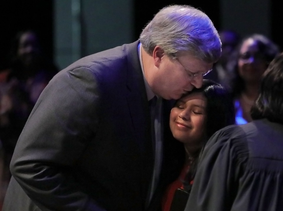<strong>Jim Strickland kisses his daughter Kathleen, who held the Bible during his inauguration, shortly after being sworn in as mayor of Memphis for a second term on Jan. 1, 2020,&nbsp;<span>at the Rose Theater on the University of Memphis campus</span>.</strong> (Patrick Lantrip/Daily Memphian)