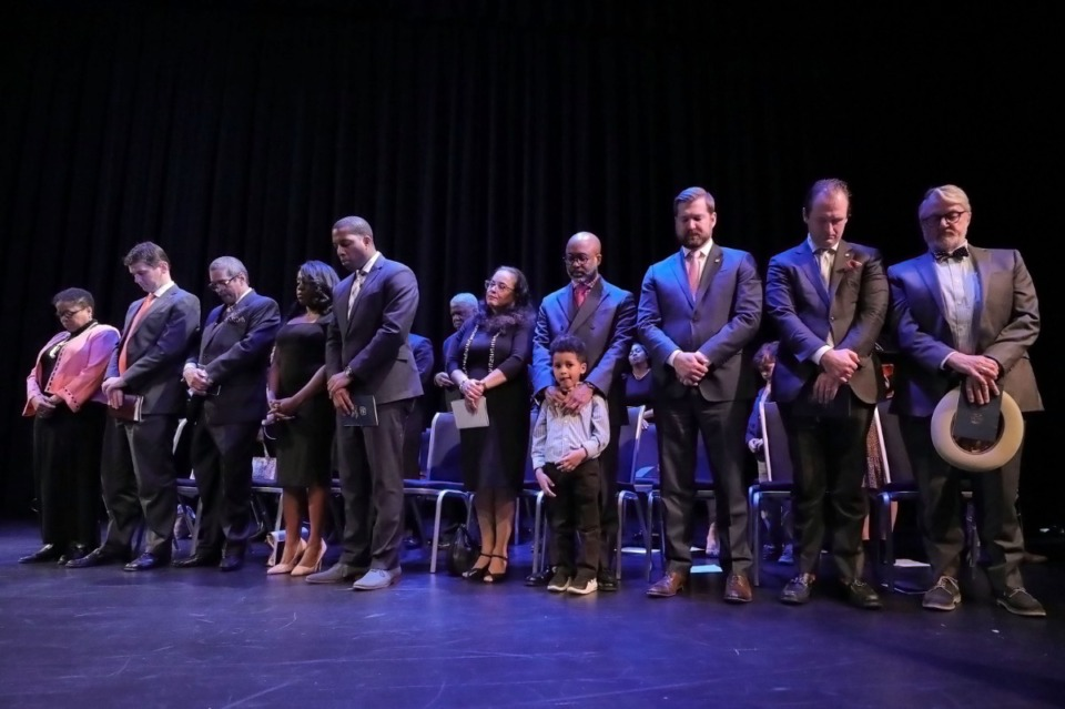 <strong>Members of the city council bow their heads in prayer while councilman Martavius Jones' son Jarred looks out at the audience during the Jan. 1, 2020, inauguration ceremony at the University of Memphis.</strong> (Patrick Lantrip/Daily Memphian)