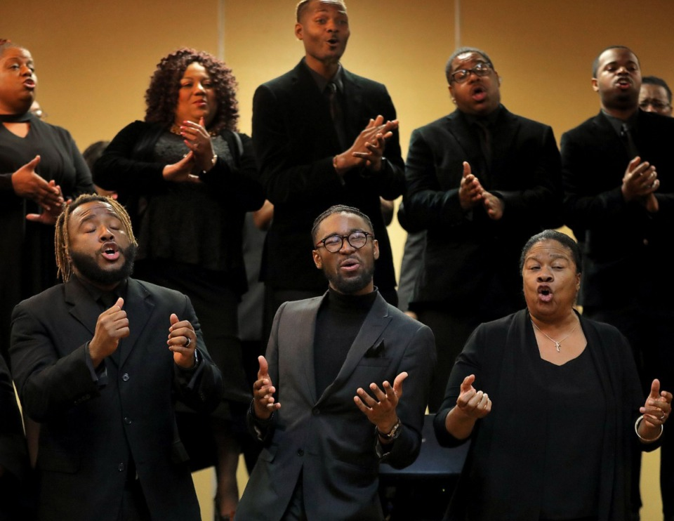 <strong>Members of the Tennessee Mass Choir including Sherman Hamilton (from left), Marques Traylor and Maggie Bratcher perform during newly-inaugurated City Court Clerk Myron Lowery's 29th annual&nbsp;<span>New Year's Day Prayer Breakfast</span> on Jan. 1, 2020.</strong> (Patrick Lantrip/Daily Memphian)