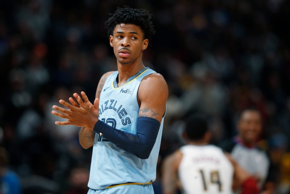 <strong>Memphis Grizzlies guard Ja Morant takes the court to face the Denver Nuggets in the first half of an NBA basketball game Saturday, Dec. 28, 2019, in Denver.</strong> (AP Photo/David Zalubowski)