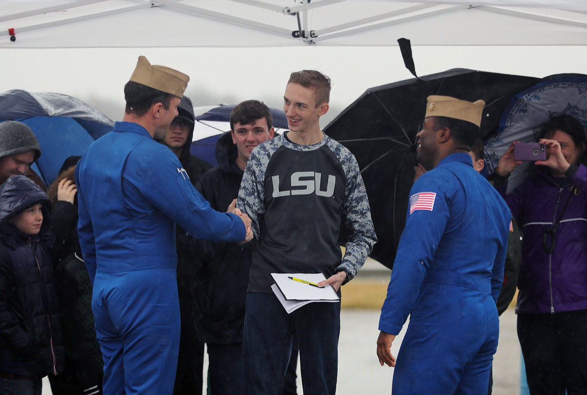 <strong>Sixteen-year-old Tommy Ducey (center) shakes hands with Lcdr. Adam Kerrick (left) and Lt. Julius Bratton (right) after getting the Blue Angels pilots' autographs at the Millington-Memphis Airport Jan. 2, 2020.</strong> (Patrick Lantrip/Daily Memphian)