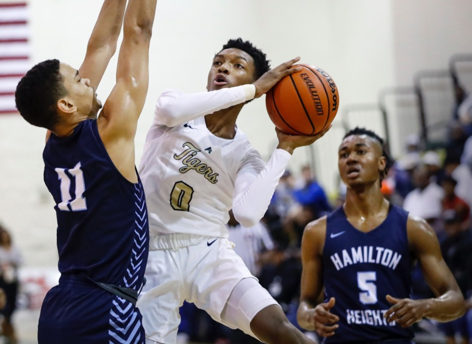 <strong>Arlington guard Ernest Smith Jr. (right) drives the lane against Hamilton Heights defender Andersson Garcia (left) during action Friday, Jan. 3, 2020, at Hoopfest.</strong> (Mark Weber/Daily Memphian)
