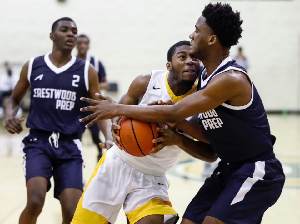 <strong>Memphis Academy of Health Sciences guard Jeveon Brown (middle) drives to the basket against Crestwood defender Romad Dean (right) during action Friday, Jan. 3, 2020, at Hoopfest.</strong> (Mark Weber/Daily Memphian)