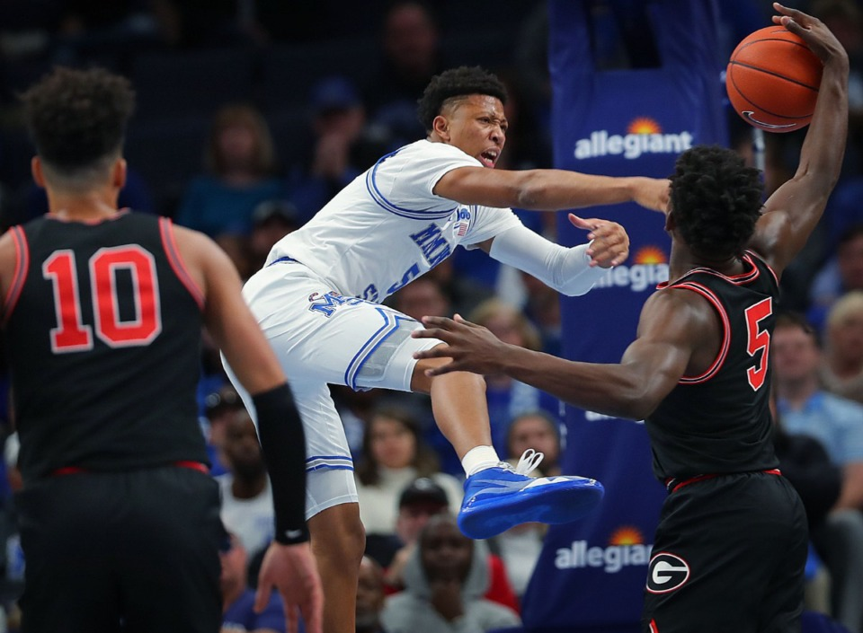 <strong>University of Memphis guard Boogie Ellis is fouled by the Bulldogs' Anthony Edwards during the Tigers' game on Jan. 4, 2020, against Georgia at the FedExForum.</strong> (Jim Weber/Daily Memphian)
