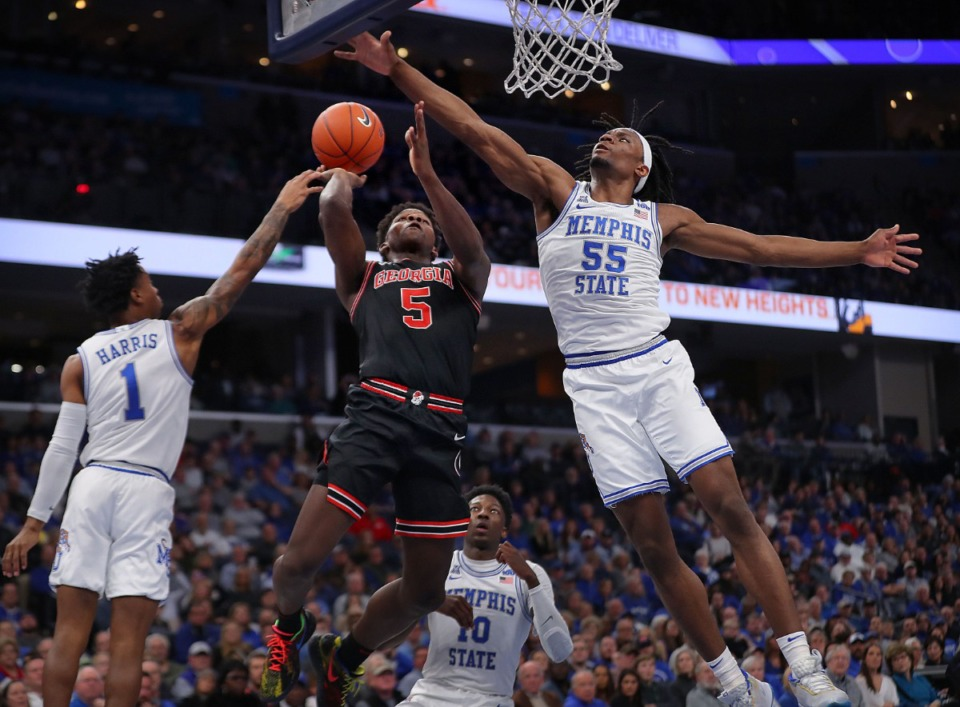 <strong>University of Memphis forward Precious Achiuwa (55) fouls the Bulldogs' Anthony Edwards (5) on a shot attempt during the Tigers' game on Jan. 4, 2020, against Georgia at the FedExForum.</strong> (Jim Weber/Daily Memphian)