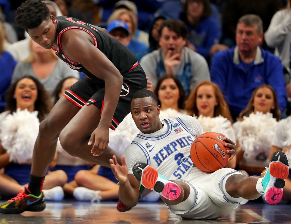 <strong>University of Memphis guard Alex Lomax (2) steals the ball from the Bulldogs' Anthony Edwards during the Tigers' game on Jan. 4, 2020, against Georgia at the FedExForum.</strong> (Jim Weber/Daily Memphian)