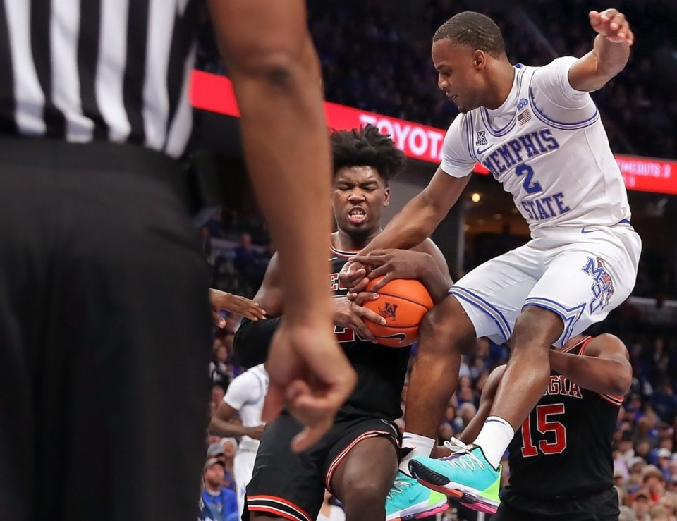 <strong>University of Memphis guard Alex Lomax (2) has the ball stripped away by the Bulldogs' Rayshaun Hammonds (center) during the Tigers' game on Jan. 4, 2020, against Georgia at the FedExForum.</strong> (Jim Weber/Daily Memphian)