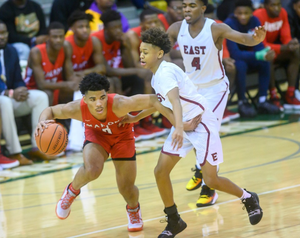 <strong>Marion High School's Detrick Reeves Jr. brings the ball around while East High School's Terrance Jacobs Jr. guards him during their Hoopfest match on Jan. 4, 2020, at Briarcrest High School.</strong> (Greg Campbell/Special to The Daily Memphian)