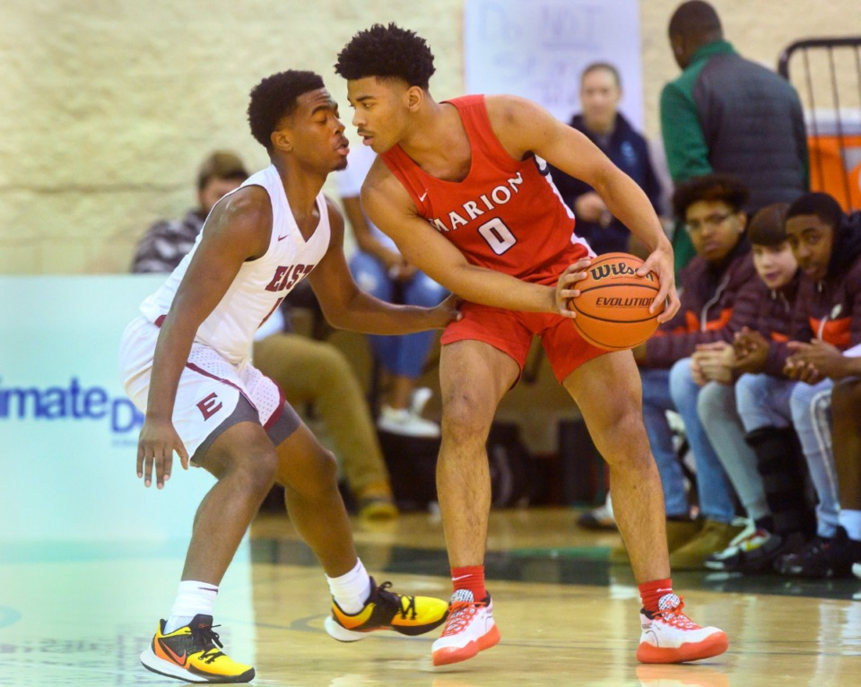 <strong>Marion High School's Detrick Reeves Jr. is guarded by East High School's Isaiah Cathey during their Hoopfest contest on Jan. 4, 2020, at Briarcrest High School.</strong> (Greg Campbell/Special to The Daily Memphian)