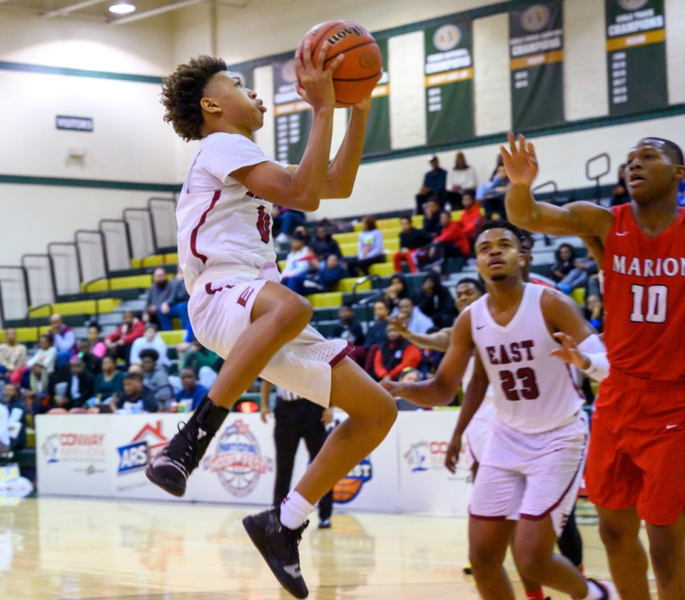 <strong>East High School point guard Terrance Jacob Jr. drives up the lane for a jump shot against Marion High School on Jan. 4, 2020, at Hoopfest at Briarcrest High School.</strong> (Greg Campbell/Special to The Daily Memphian)