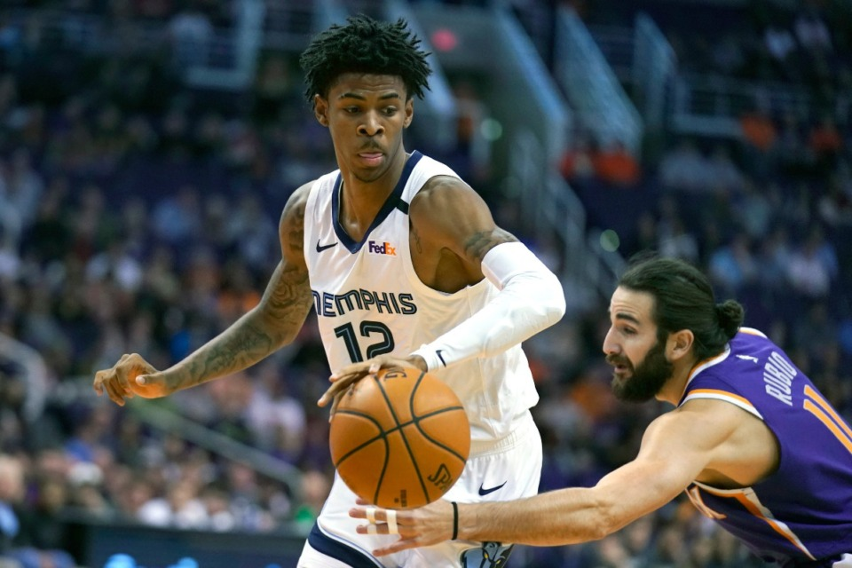 <strong>Memphis Grizzlies guard Ja Morant (12) drives against Phoenix Suns guard Ricky Rubio during an NBA basketball game, Sunday, Jan. 5, 2020, in Phoenix.</strong> (Rick Scuteri/AP)