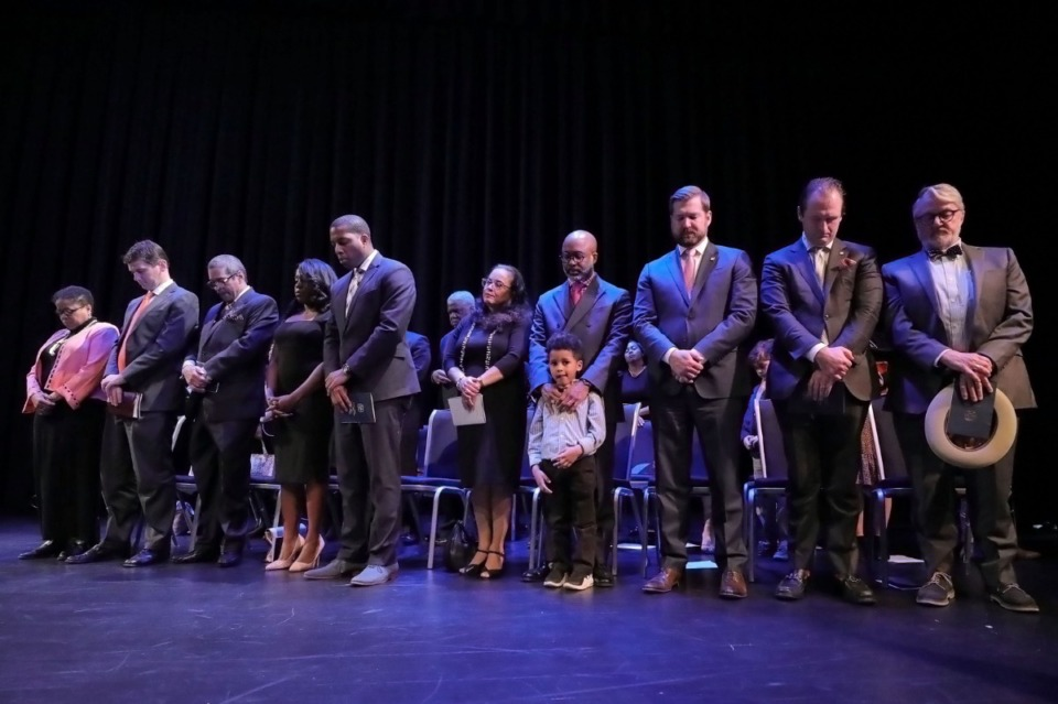<strong>Members of the city council bow their heads in prayer while councilman Martavius Jones' son Jarred looks out at the audience during the Jan. 1, 2020 inauguration ceremony at the University of Memphis.</strong> (Patrick Lantrip/Daily Memphian)