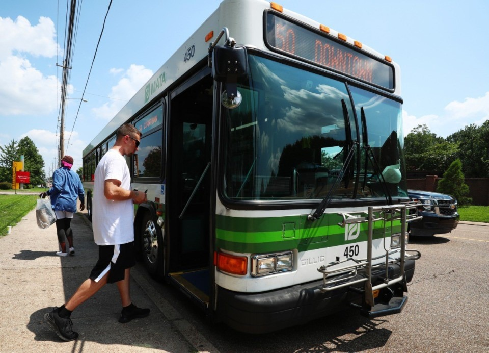 <strong>A passenger boards a MATA bus. The Shelby County Commission will consider a wheel tax Jan. 8 that would help fund public transit.</strong> (Daily Memphian file)