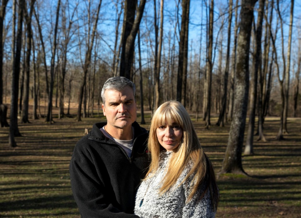 <strong>Alfredo Perez and Soraya Jalil say they bought their home on Tall Forest Lane in southeast Shelby County because of its large lot, beautiful trees and the area's quiet, rural feel. But they say proposals to construct dense housing will dramatically change the area.</strong> (Mike Kerr/Special to the Daily Memphian)