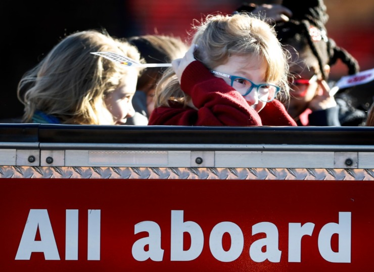 "<strong>St. Francis of Assisi Catholic School second grader Addison Ballard, 7, (right) covers her ears as a horn blows while riding CN Railway's safety train, ""Little Obie,"" on Jan. 7, 2020, in Cordova.</strong> (Mark Weber/Daily Memphian)"