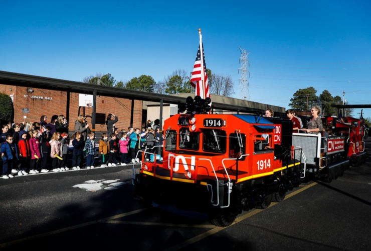"<strong>CN Railway's safety train, ""Little Obie"" delivered a Memphis in May World Cargo Crate from Ghana to St. Francis of Assisi Catholic School on Jan. 7, 2020, in Cordova.</strong> (Mark Weber/Daily Memphian)"