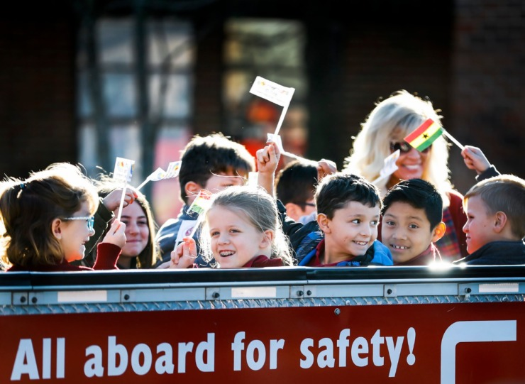 "<strong>St. Francis of Assisi Catholic School students wave Memphis in May and flags of 2020 honored country Ghana as they ride CN Railway's safety train, ""Little Obie"", on Jan. 7, 2020, at the Cordova campus.</strong> (Mark Weber/Daily Memphian)"
