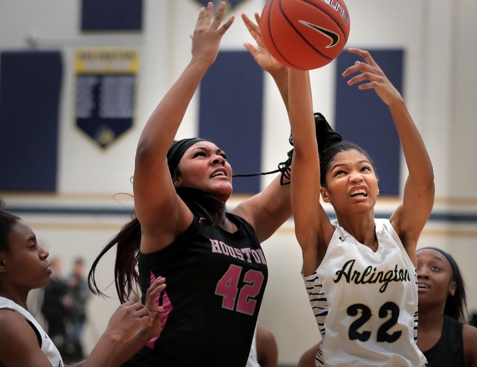 <strong>Lady Mustangs post Mallory Collier (42) battles for a rebound with the Tigers' Taylor Dupree during Houston High School's girls basketball game against Arlington on Jan. 7, 2020, at Arlington High School.</strong> (Jim Weber/Daily Memphian)