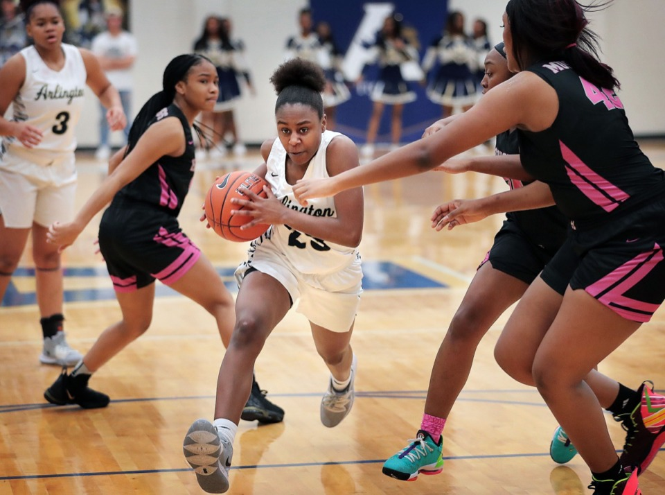 <strong>The Lady Tigers' Carmen Taylor (23) finds an open lane to score during Houston High School's girls basketball game against Arlington on Jan. 7, 2020, at Arlington High School.</strong> (Jim Weber/Daily Memphian)