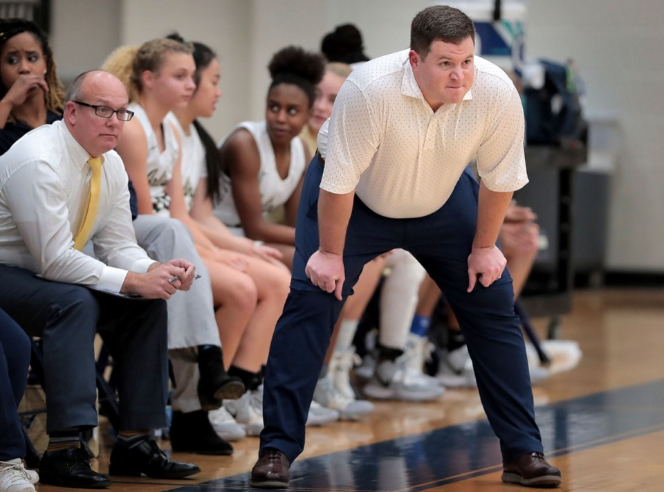 <strong>Lady Tigers coach Wesley Shappley (right) watches his defense during Houston High School's girls basketball game against Arlington on Jan. 7, 2020, at Arlington High School.</strong> (Jim Weber/Daily Memphian) Carmen Taylor (23)