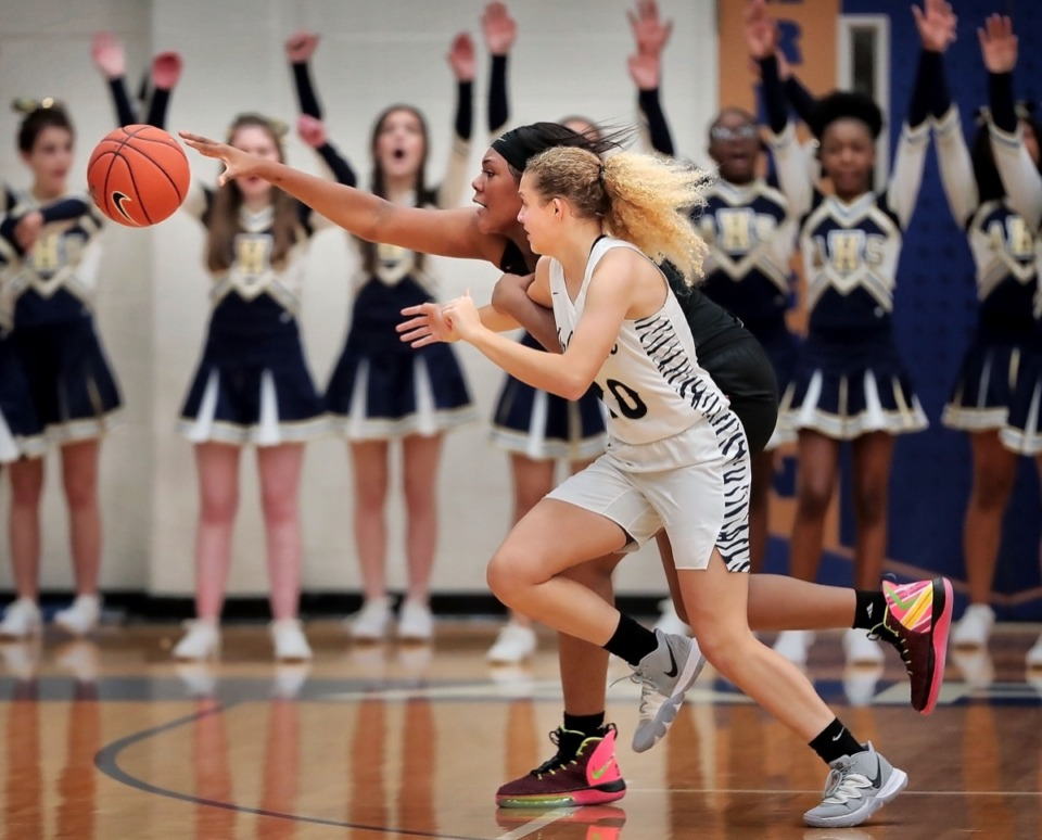 <strong>Lady Mustangs post Mallory Collier (left) battles for a loose ball with the Tigers' Alindsey Long during Houston High School's girls basketball game against Arlington on Jan. 7, 2020, at Arlington High School.</strong> (Jim Weber/Daily Memphian)