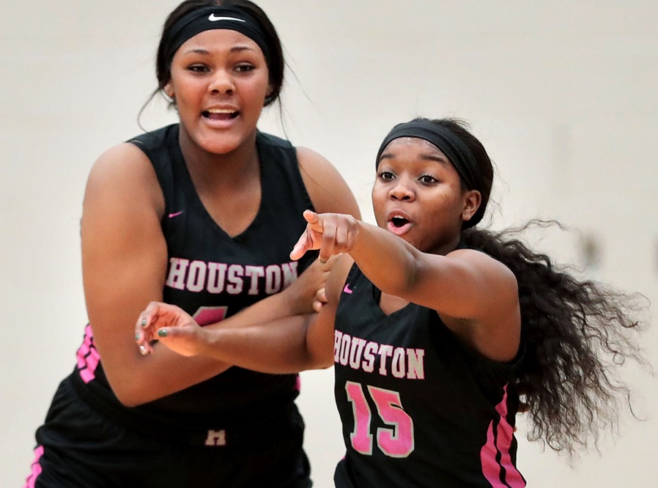<strong>Lady Mustangs post Mallory Collier (left) and guard Zipporah Davis call out the incoming offense during Houston High School's girls basketball game against Arlington on Jan. 7, 2020, at Arlington High School.</strong> (Jim Weber/Daily Memphian)