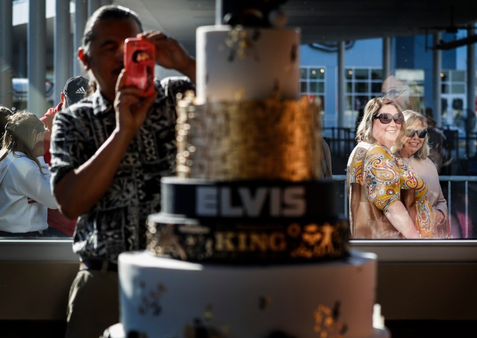 <strong>Elvis fans Heather Crews (second right) and Tisha Schauer (far right) smile through a window while attending a celebration for what would have been Elvis Presley's 85th birthday on Jan. 8, 2020, at Graceland.</strong> (Mark Weber/Daily Memphian)