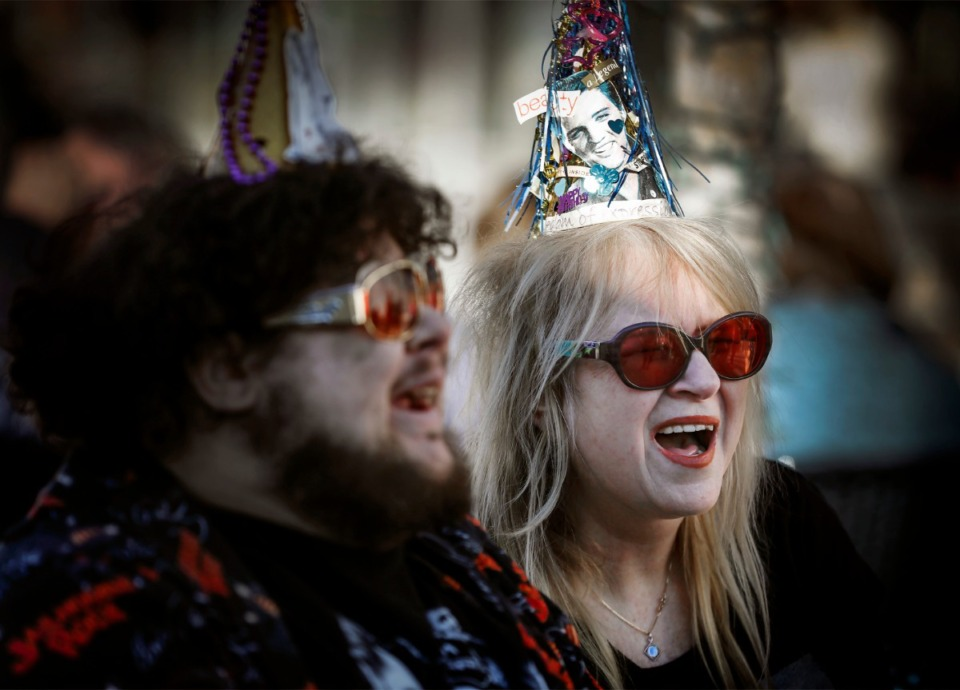 <strong>Elvis fans David Smock (left) and Victoria Pamore (right) wore birthday hats while attending a celebration at Graceland on what would have been Elvis Presley's 85th birthday on Jan. 8, 2020.&nbsp;</strong>(Mark Weber/Daily Memphian)
