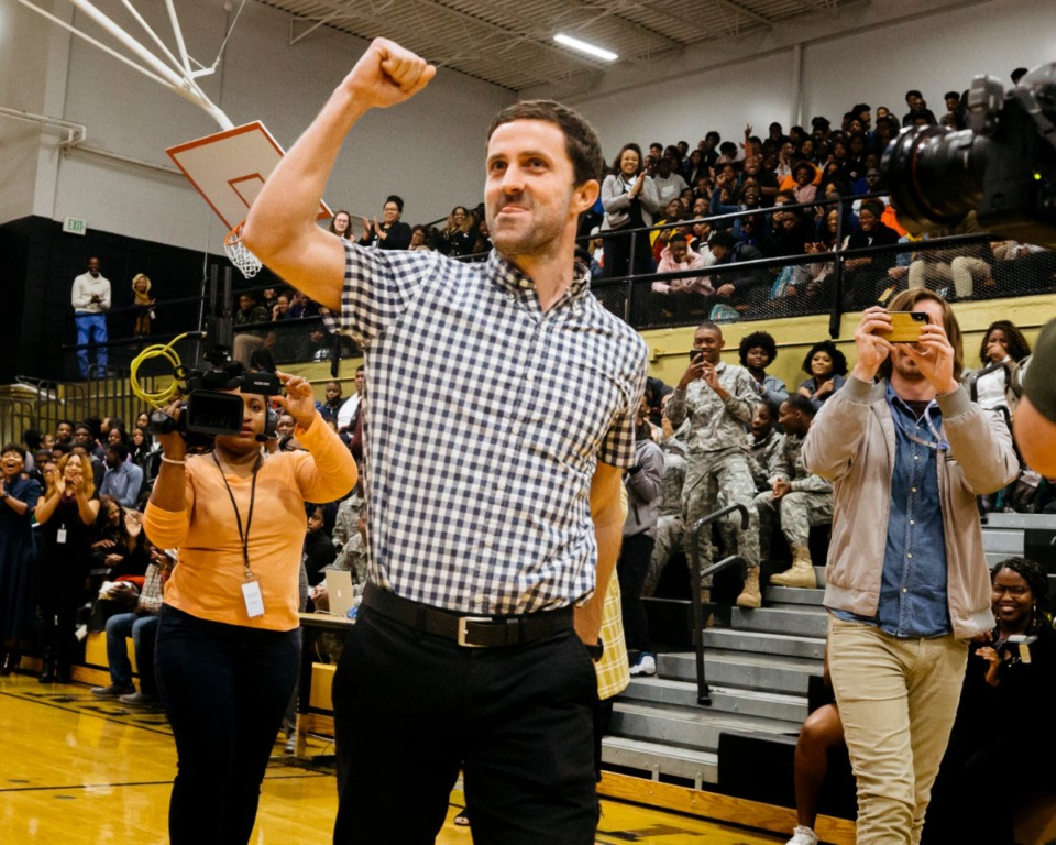 <strong>Whitehaven High School math teacher Nathan Kirsch celebrates after receiving the Milken Educator Award on Wednesday, Jan. 8, during a pep rally at Whitehaven High. The prestigious award comes with $25,000.</strong> (Ziggy Mack/Special to the Daily Memphian)