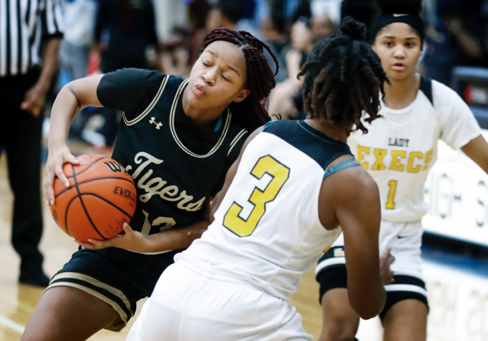 <strong>Whitehaven guard Kakeria Hawkins (left) makes a move to get around Memphis Business Academy defender Timyja Threlkeld (right) Jan. 2, 2020, at Arlington High School.</strong> (Mark Weber/Daily Memphian)