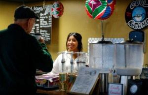 <strong>Cool Beans co-owner Brisa Rodriguez serves customers at the recently-opened coffee shop inside the Cordova International Farmer's Market on Jan. 6, 2020.</strong> (Mark Weber/Daily Memphian)