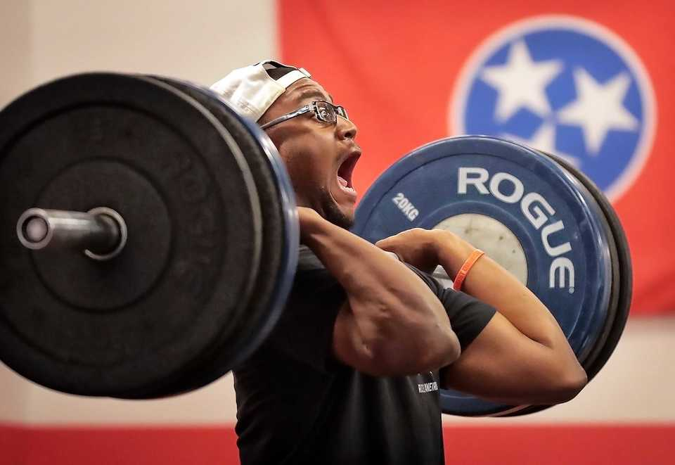 <strong>Tony Butler executes a clean and jerk at the Crossfit Hit & Run on Poplar Avenue on Nov. 6, 2018. The gym recently signed a lease to take over the Glitter & Glamour space across from Crosstown Concourse.</strong> (Jim Weber/Daily Memphian)