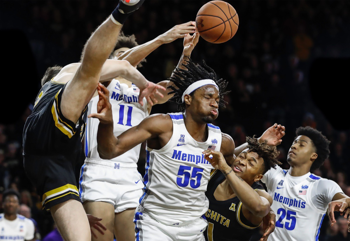 <strong>Memphis forward Precious Achiuwa (middle) battles Wichita State defender Tyson Etienne (middle right) for a rebound as teammate Jayden Hardaway (right) helps on the play Jan. 9, 2020, in Wichita, Kansas.</strong> (Mark Weber/Daily Memphian)