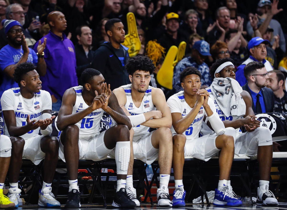 <strong>Memphis teammates (left to right) Damion Baugh, Lance Thomas, Isaiah Maurice, Boogie Ellis and Malcolm Dandridge watch from the bench during the final minutes of a 76-67 loss to Wichita State Jan. 9, 2020, in Wichita, Kansas.</strong> (Mark Weber/Daily Memphian)